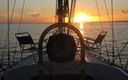 sunset on sailboat